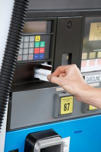 charging gasoline at the fuel pump with credit card