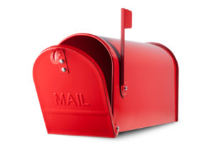Red mailbox on white background